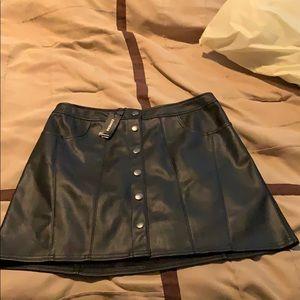 Black leather mini skirt.